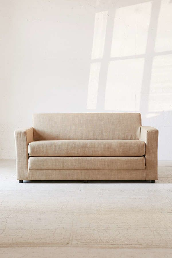 """This <a href=""""https://www.urbanoutfitters.com/shop/anywhere-sleeper-sofa?category=sofas&color=014&quantity=1&size"""