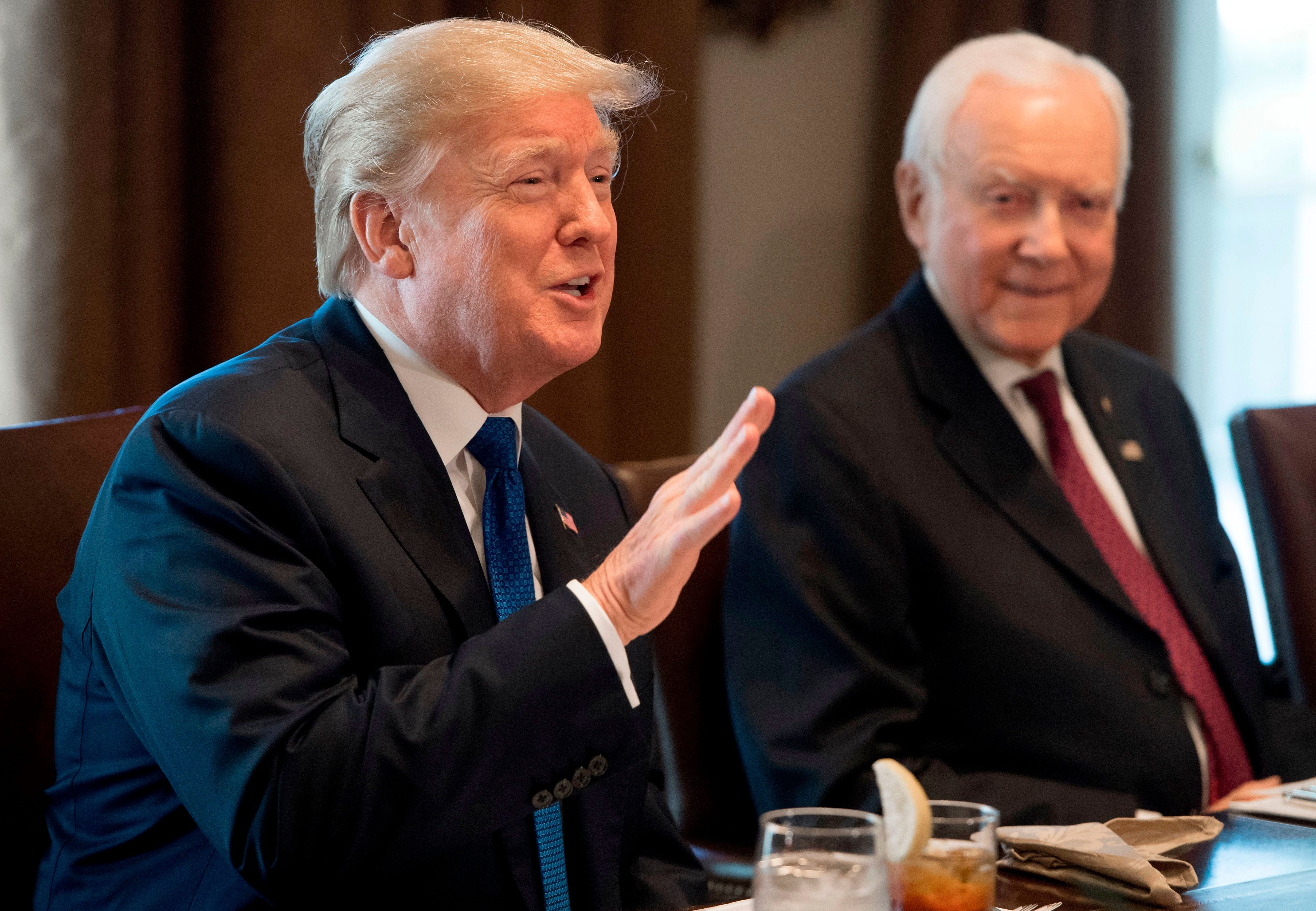 US President Donald Trump speaks about tax reform legislation during a lunch with lawmakers working on the tax reform conference committee, including Senator Orrin Hatch (R), Republican of Utah, in the Cabinet Room at the White House in Washington, DC, December 13, 2017. / AFP PHOTO / SAUL LOEB        (Photo credit should read SAUL LOEB/AFP/Getty Images)