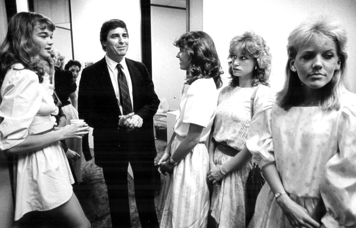 Potential models wait outside the office of Elite Model Management founder John Casablancas in 1983.