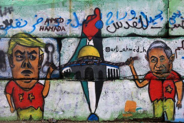 Amural in Gaza depicts U.S.President Donald Trumpwith Israeli President Benjamin Netanyahu...