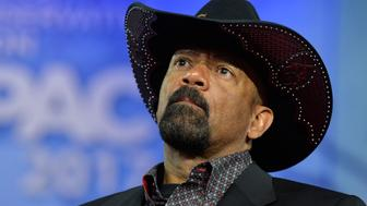 Milwaukee County Sheriff David A. Clarke, Jr. listens to remarks during the Conservative Political Action Conference (CPAC) at National Harbor, Maryland, February 23, 2017. Politicians, pundits, journalists and celebrities gather for the annual conservative event to hear speakers, network and plan agendas for the new President Trump administration.    / AFP / Mike Theiler        (Photo credit should read MIKE THEILER/AFP/Getty Images)