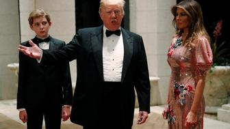 U.S. President Donald Trump and first lady Melania Trump, with their son Barron, arrive for a New Year's Eve party at his Mar-a-Lago club in Palm Beach, Florida, U.S. December 31, 2017.  REUTERS/Jonathan Ernst