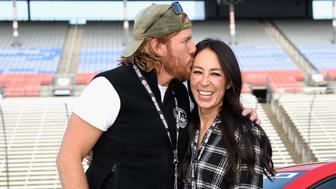 FORT WORTH, TX - NOVEMBER 05:  'Fixer Upper' stars Chip and Joanna Gaines pose with the Monster Energy NASCAR Cup Series AAA Texas 500 pace car at Texas Motor Speedway on November 5, 2017 in Fort Worth, Texas.  (Photo by Jared C. Tilton/Getty Images)