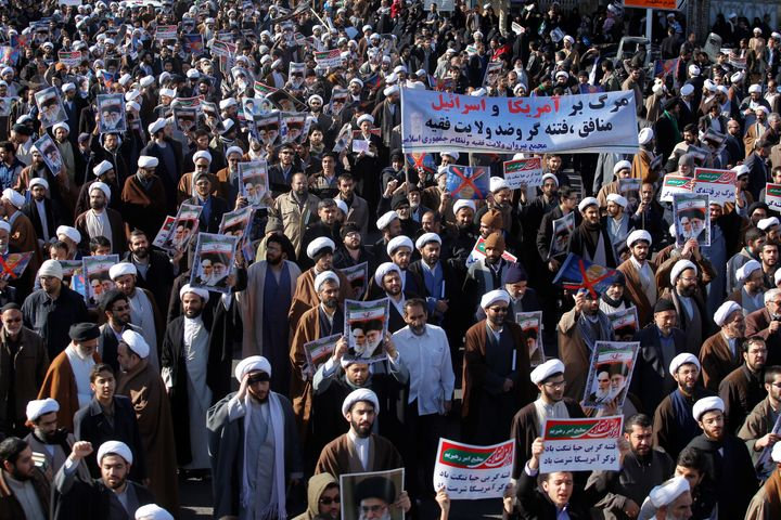 Iranians take part in a state-organized rally against anti-government protests.