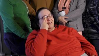 Lisa Finch, surrounded by family members, reacts on Friday, Dec. 29, 2017, to the killing of her son, Andrew Finch, after he was shot Thursday evening by police. The shooting may have been related to what online gamers have said in multiple Twitter posts that the shooting of Finch by Wichita, Kan., police was the result of a 'swatting' prank involving two gamers. (Bo Rader/Wichita Eagle/TNS via Getty Images)