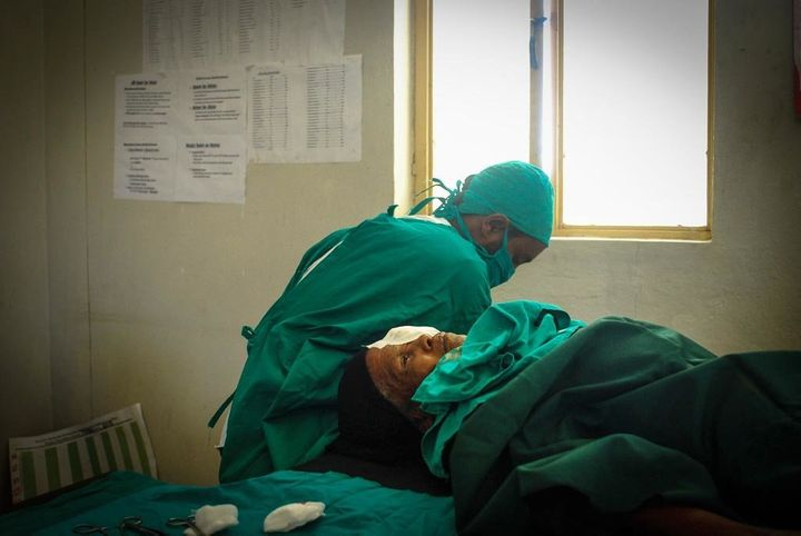 Bugune, still under anaesthetic, lies on the operating table after receiving the simple and cheap eyelid surgery that saved h