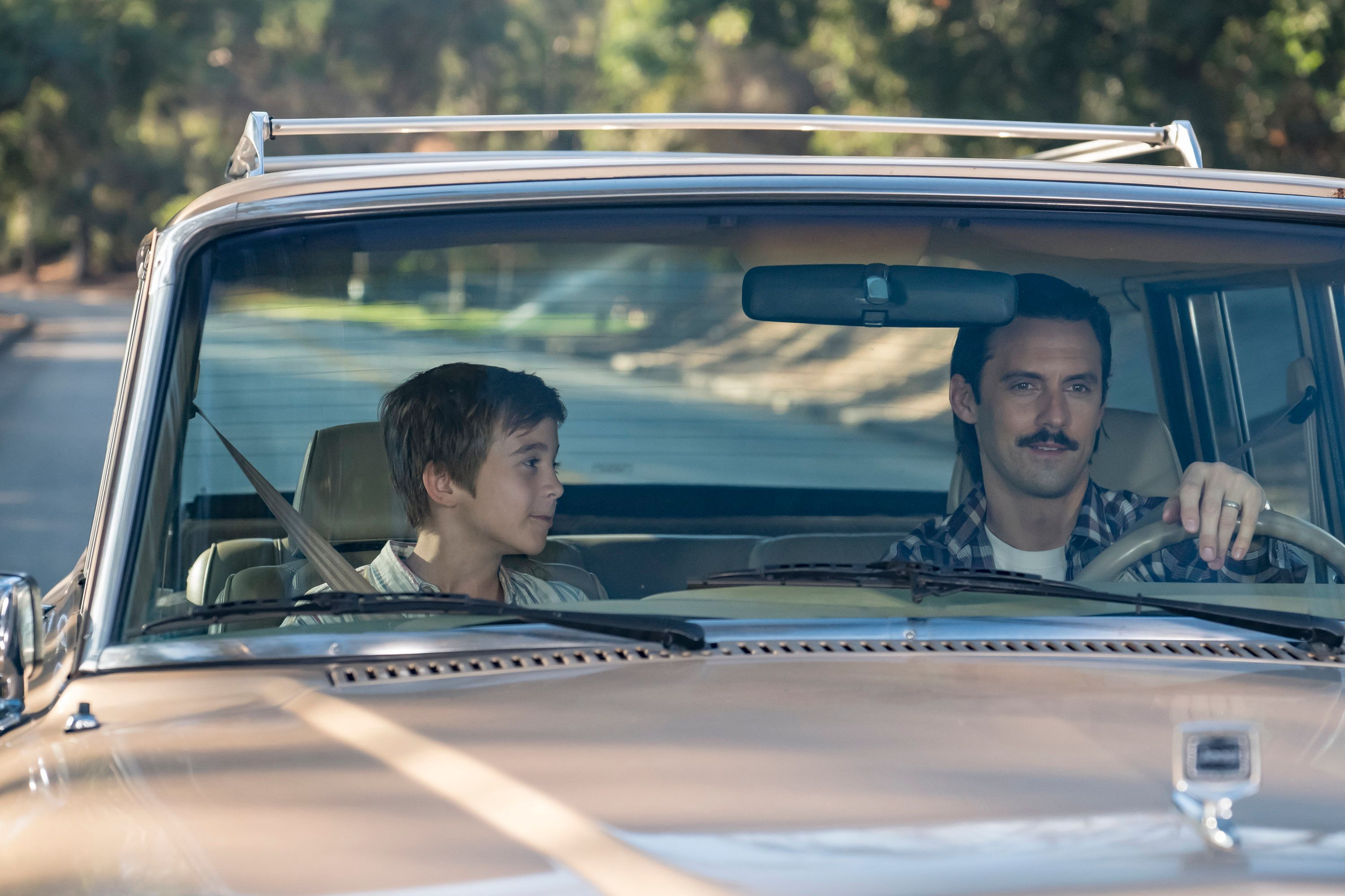 Parker Bates as Young Kevin and Milo Ventimiglia as Jack in