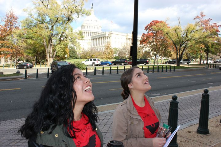 Leydy Rangel, left, and Eloisa Torres, DACA recipients from Bakersfield, work up their enthusiasm before going to speak to Ho