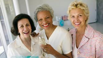 Three mature women smiling, portrait