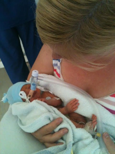 Catriona Ogilvy holding her son Sam for the first time at six days old.