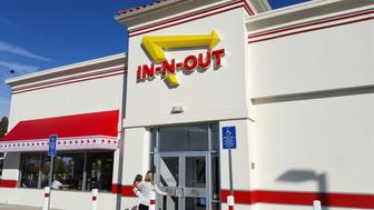 Medford, OR, USA - November 7, 2015: In-N-Out Burger, Inc. is a regional chain of fast food restaurants with locations primarily in the American Southwest and Pacific coast.The chain is currently headquartered in Irvine, California. In-N-Out Burger has slowly expanded outside Southern California into the rest of California, as well as into Arizona, Nevada, Utah, Texas and recently Oregon