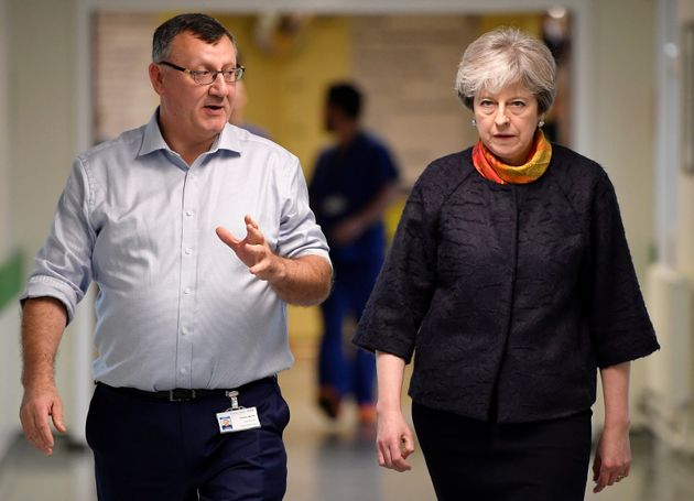 Theresa May Apologises For 'Frustrating' Delays To NHS