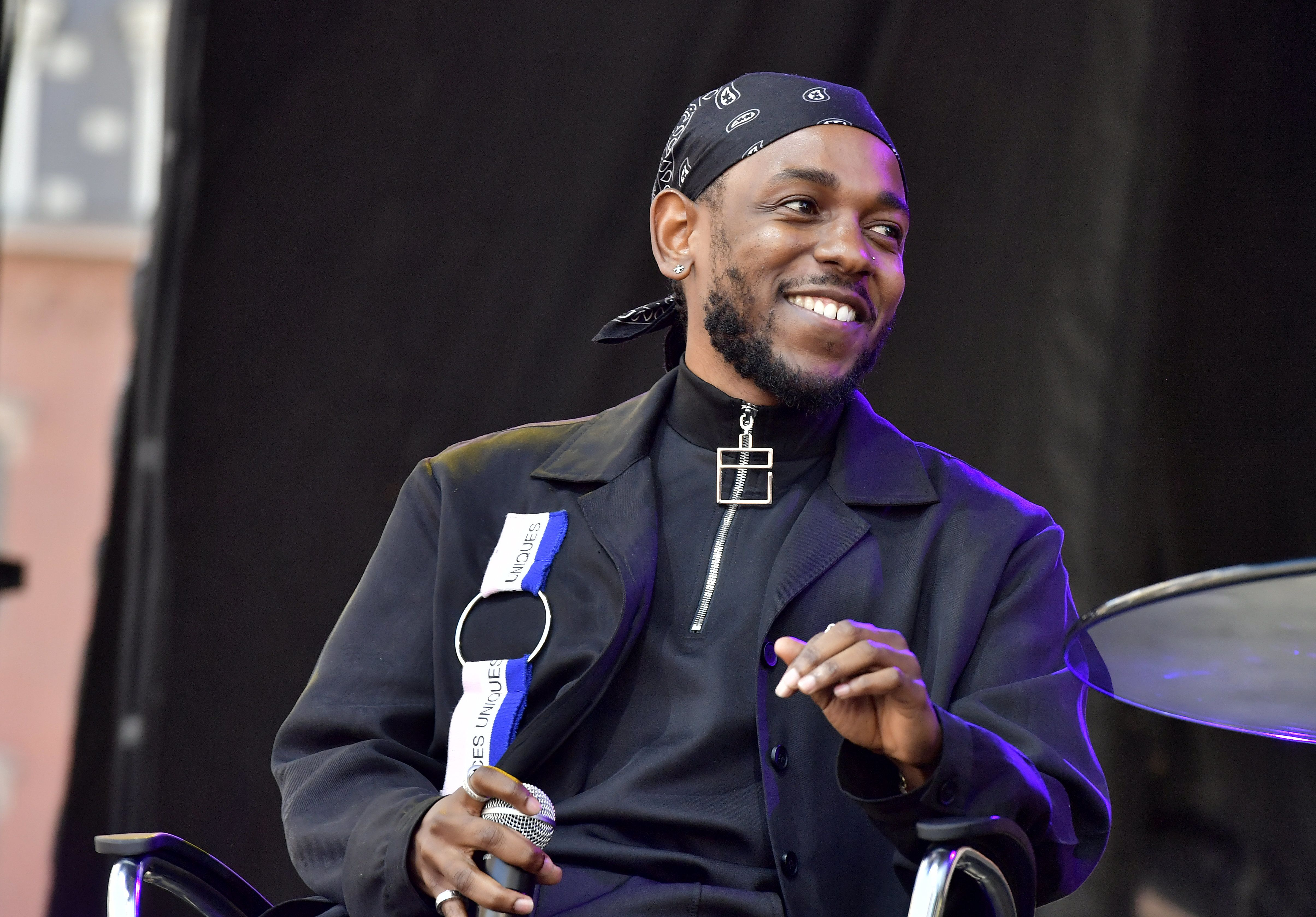 BOSTON, MA - OCTOBER 03:  Rapper Kendrick Lamar is interviewed by Forbes Magazine Senior Editor Zack O'Malley Greenburg at the 2017 Forbes Under 30 Summit on October 3, 2017 in Boston, Massachusetts.  (Photo by Paul Marotta/Getty Images)
