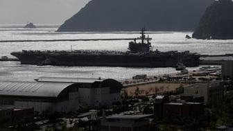 BUSAN, SOUTH KOREA - OCTOBER 21:  US aircraft carrier Ronald Reagan anchored at Busan Naval Base on October 21, 2017 in Busan, South Korea. The nuclear-powered aircraft carrier took part in a military drill off the Korean Peninsula. U.S. President Donald Trump will visit Japan, South Korea and China from November 5.  (Photo by Woohae Cho/Getty Images)
