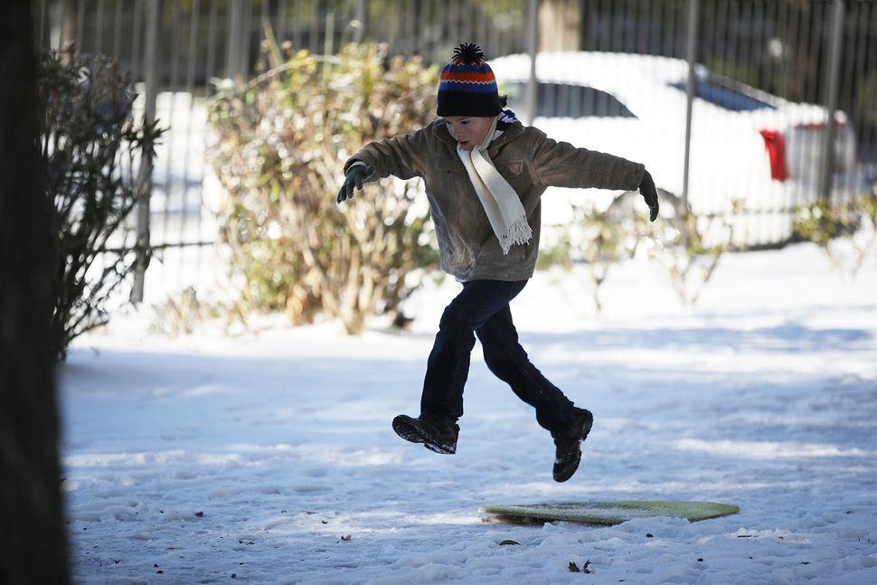 Jediah Pendergrass plays in the snow in Savannah, Georgia.