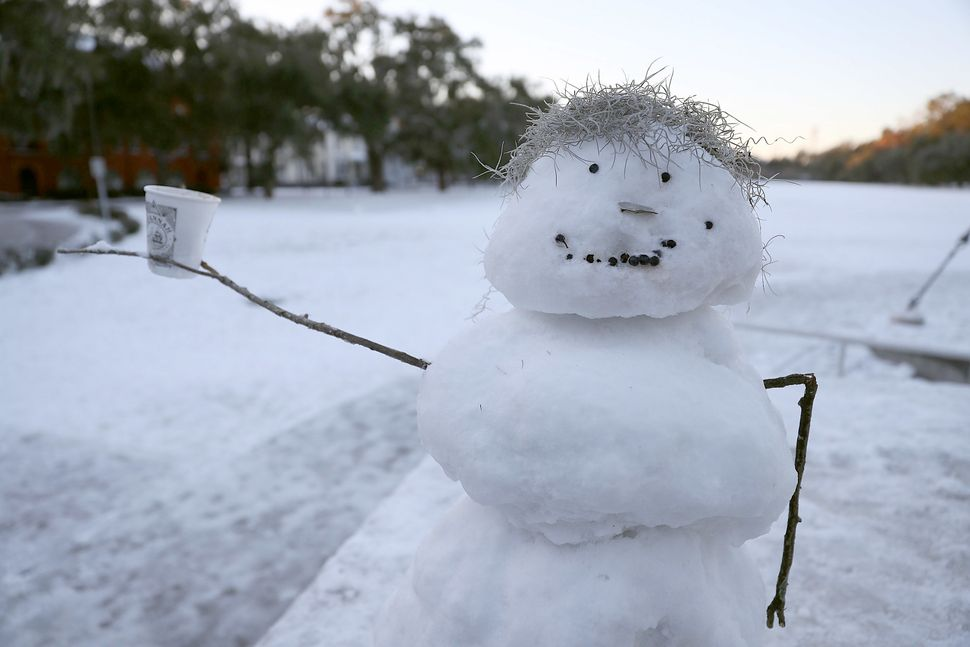 A snowman is seen as snow blankets the area on Jan. 4, 2018 in Savannah, Georgia.