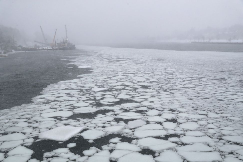 Ice flows through the New Haven Harbor on Jan. 4, 2018 in New Haven, Connecticut.