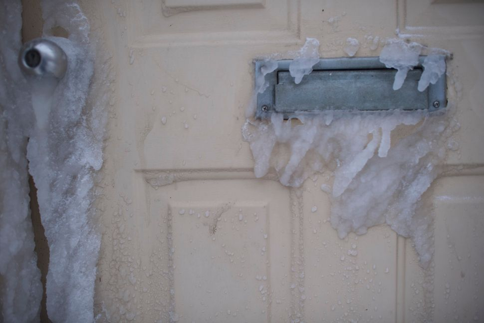 Ice forms on the front door of a residence on Jan. 4, 2018 in Atlantic City, New Jersey.