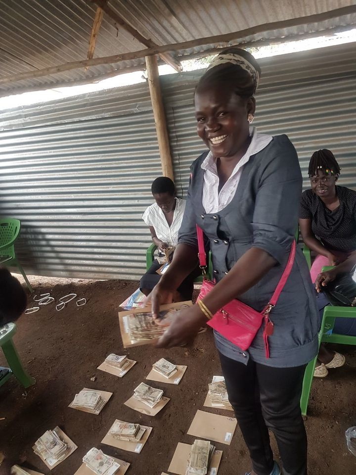 <p>WomenStrong Consortium Member AVFP's Group Savings & Loan Member preparing to distribute group savings at the end of 2017</p>