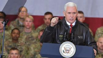 US Vice President Mike Pence arrives on stage to address troops in a hangar at Bagram Air Field in Afghanistan on December 21, 2017. POOL / AFP PHOTO / POOL / MANDEL NGAN        (Photo credit should read MANDEL NGAN/AFP/Getty Images)