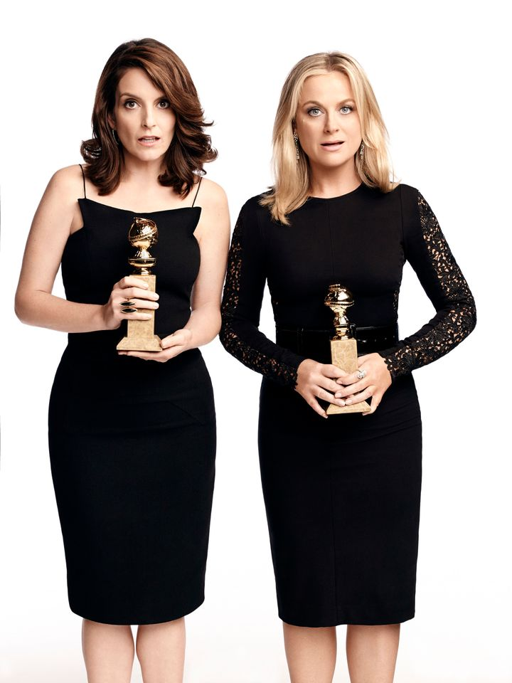 Tina Fey and Amy Poehler pose together as hosts for the 72nd Annual Golden Globes.