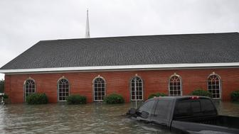 PORT ARTHUR, TX - AUGUST 30:  A church is surrounded by water after the flooding of Hurricane Harvey inundated the area on August 30, 2017 in Port Arthur, Texas. Harvey, which made landfall north of Corpus Christi late Friday evening, is expected to dump upwards to 40 inches of rain in Texas over the next couple of days.  (Photo by Joe Raedle/Getty Images)