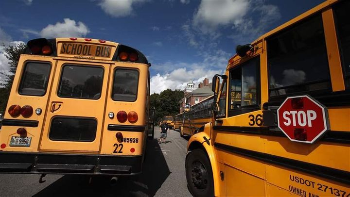 School buses await students at a York, Maine, middle school. Clean-energy advocates say school buses are likely targets for s