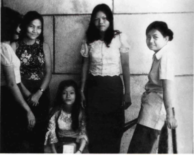 My lost sister Chea, seated with her college friends, before the Khmer Rouge takeover.