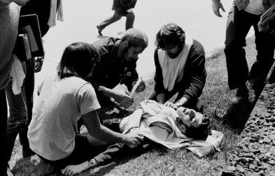 Wounded Kent State student John Cleary grimaces as ill-equipped students fight to save his life, May 4, 1970.