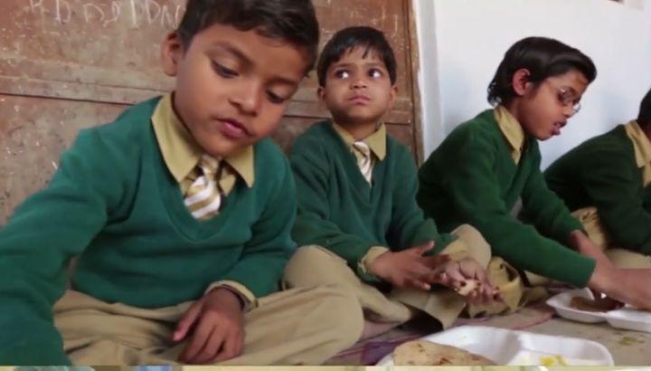 <p>Schoolchildren eating Akshaya Patra-provided meal.</p>