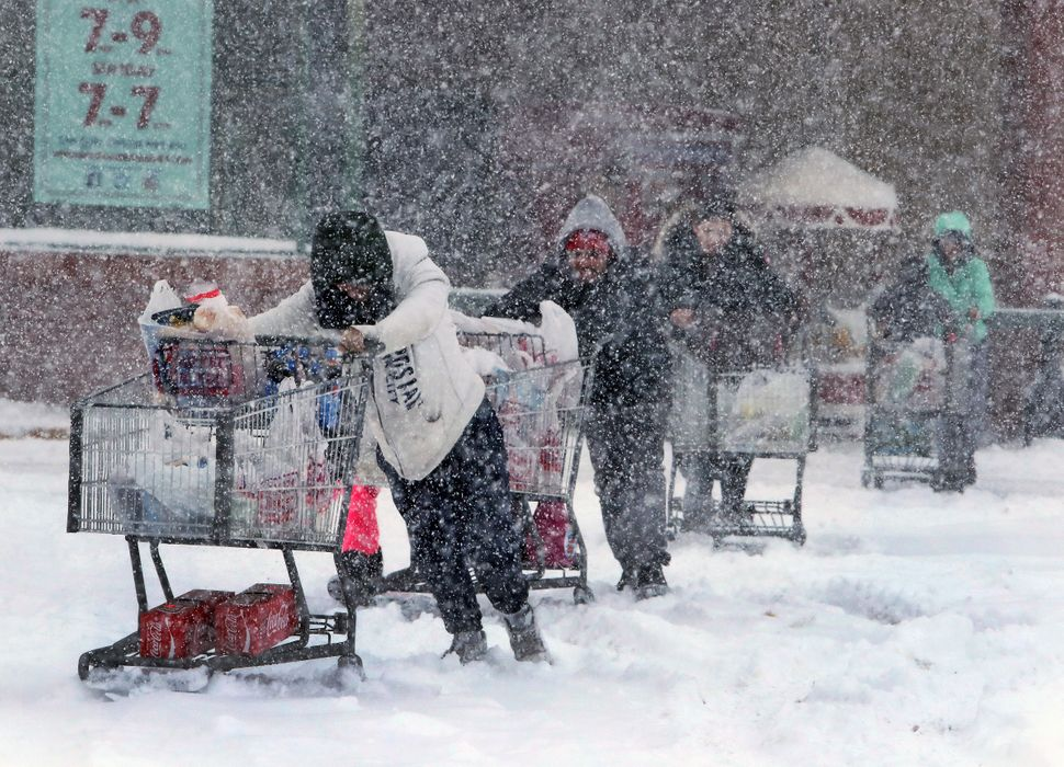 Shoppers brave the snow to stock up on items at the Market Basket grocery store on Pleasant Valley Street in Methuen, Ma