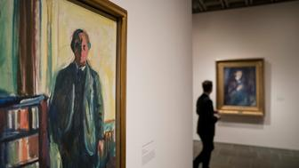 NEW YORK, NY - NOVEMBER 13: A man pauses in the self-portrait section of the Edward Munch exhibition titled 'Between The Clock and The Bed' at the Met Breuer, November 13, 2017 in New York City. The exhibit features 43 of the Norwegian artist's works, including 16 self-portraits. (Drew Angerer/Getty Images)