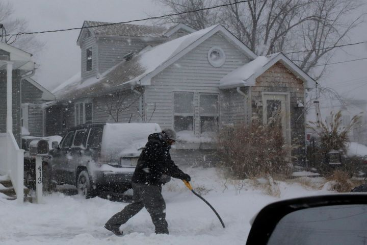 A man shovels snow outside a home in Union Beach, New Jersey, on Jan. 4, 2018.