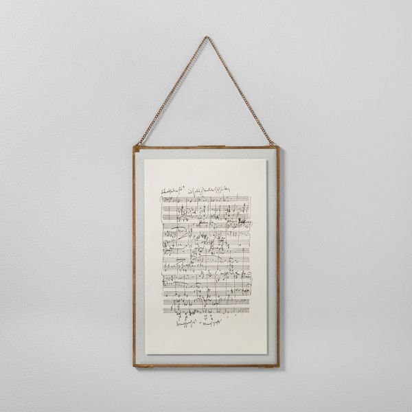 """Get it <a href=""""https://www.target.com/p/music-notes-framed-wall-art-12-x18-brass-hearth-hand-153-with-magnolia/-/A-52587863#"""