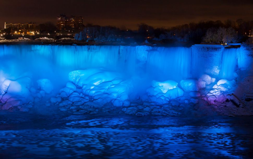 Ice and water flow over the American Falls, viewed from the Canadian side in Niagara Falls, Ontario, Canada, Jan. 2, 2018.