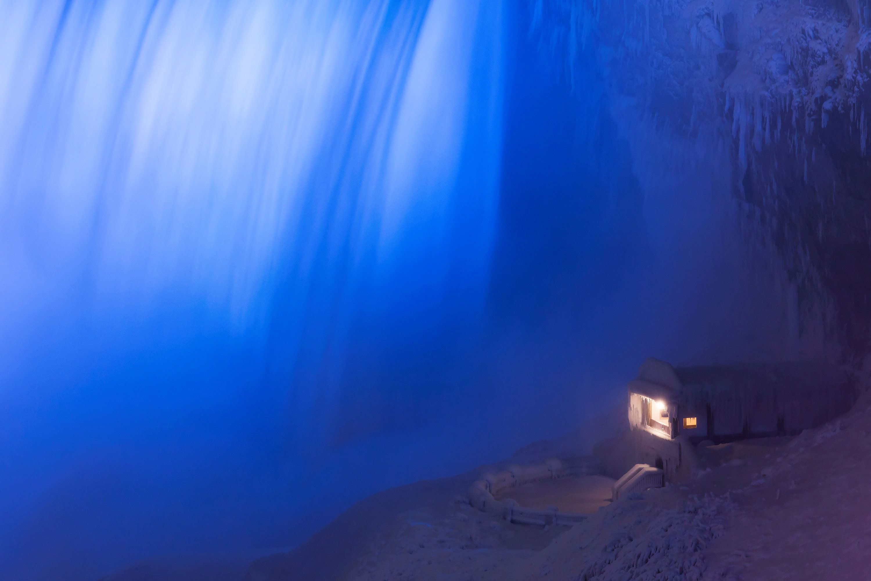 A building covered in ice sits at the base of the Horseshoe Falls in Niagara Falls, Ontario, Canada,...