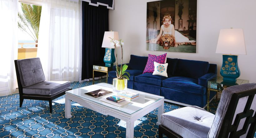 """<em>Above, a deep blue velvet sofa adds bold color that doesn't take over the room in a space at Eau Palm Beach</em> <a rel="""""""