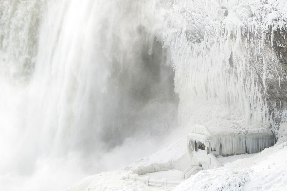 Ice coats the rocks and observation deck at the base of Horseshoe falls in Niagara Falls,