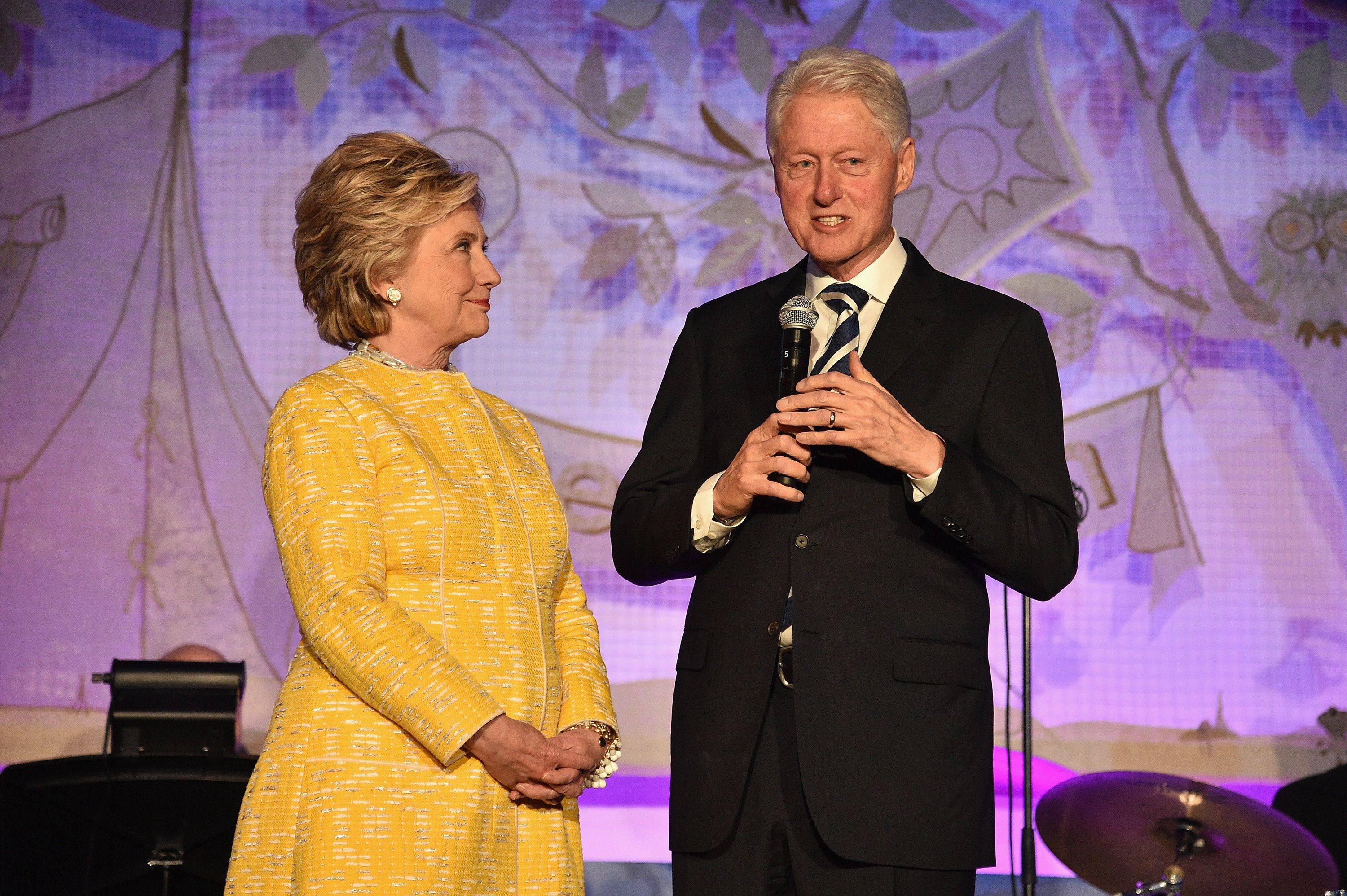 Former Secretary of State Hillary Clinton and former President Bill Clinton speak onstage during the SeriousFun Children's Ne