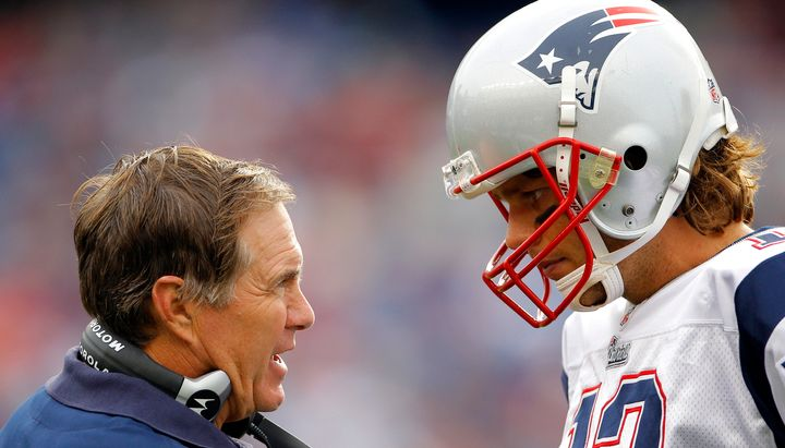 Bill Belichick talks with Tom Brady at the tail end of a game in Foxborough, Massachusetts, in 2010.