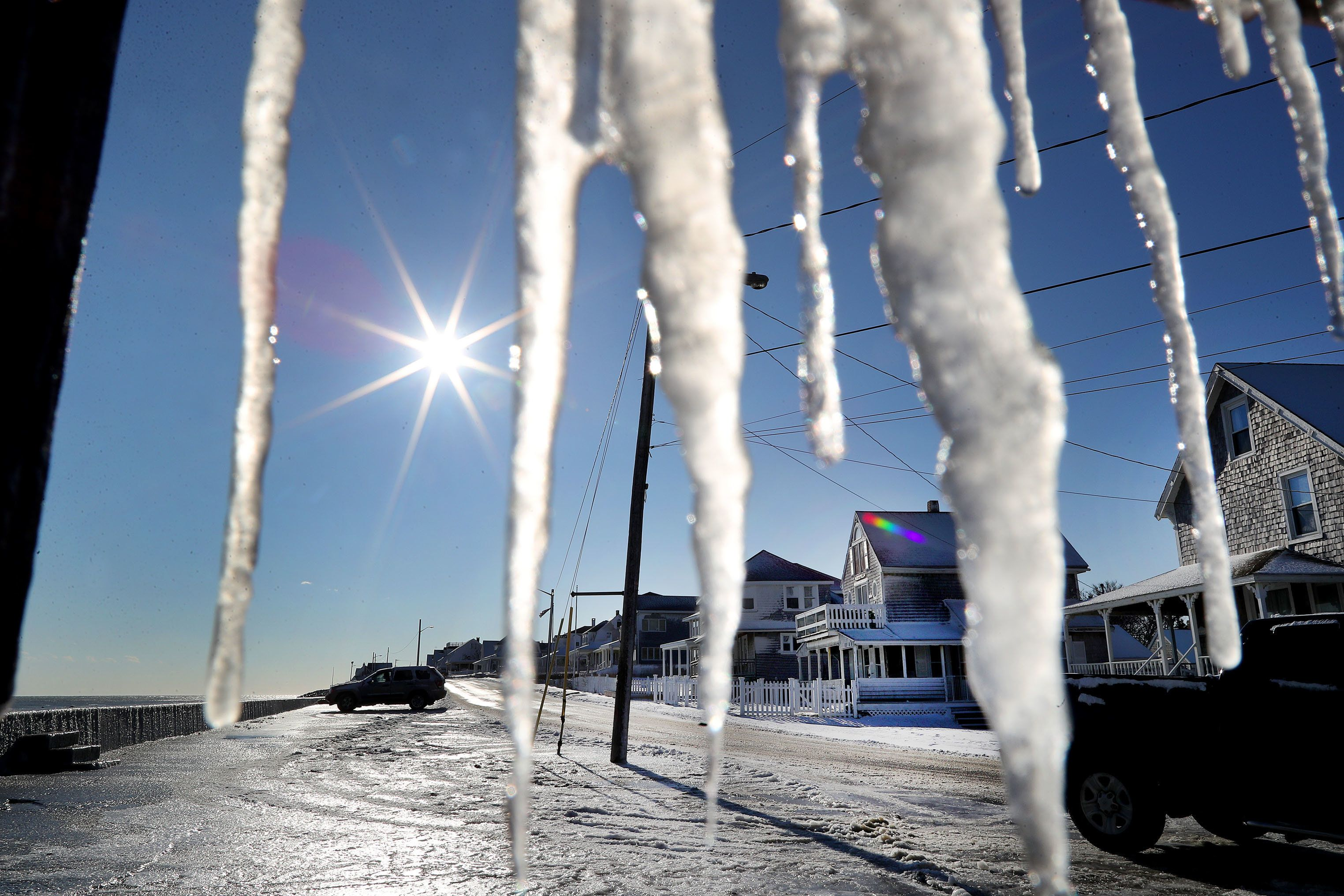 Icicles hang from a porch in Marshfield, Massachusetts on January 5, 2018.