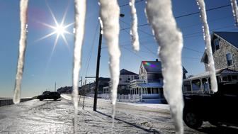 MARSHFIELD, MA - JANUARY 5: Icicles hang from a porch on Ocean Street as cleanup takes place in the Brant Rock section of Marshfield, MA after a winter storm that flooded much of the area on Jan. 5, 2018. (Photo by John Tlumacki/The Boston Globe via Getty Images)