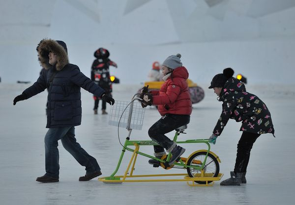Tourists visit the Harbin International Snow Sculpture Art Expo.