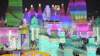 HARBIN, CHINA - JANUARY 05: An illuminated ice castle is seen during the Harbin International Ice and Snow Sculpture Festival at Harbin Sun Island International Snow Sculpture Art Expo in Harbin, China on January 05, 2018. The Festival, established in 1985, is held annually on January 5 and lasts over a month.   (Photo by Stringer/Anadolu Agency/Getty Images)