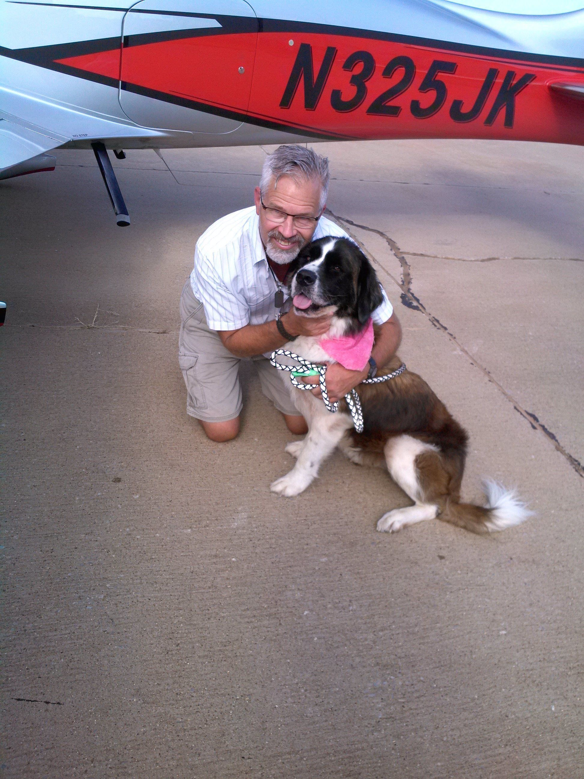 Kinsinger in a photo provided by Pilots N Paws, seen with a dog named Big Sid.