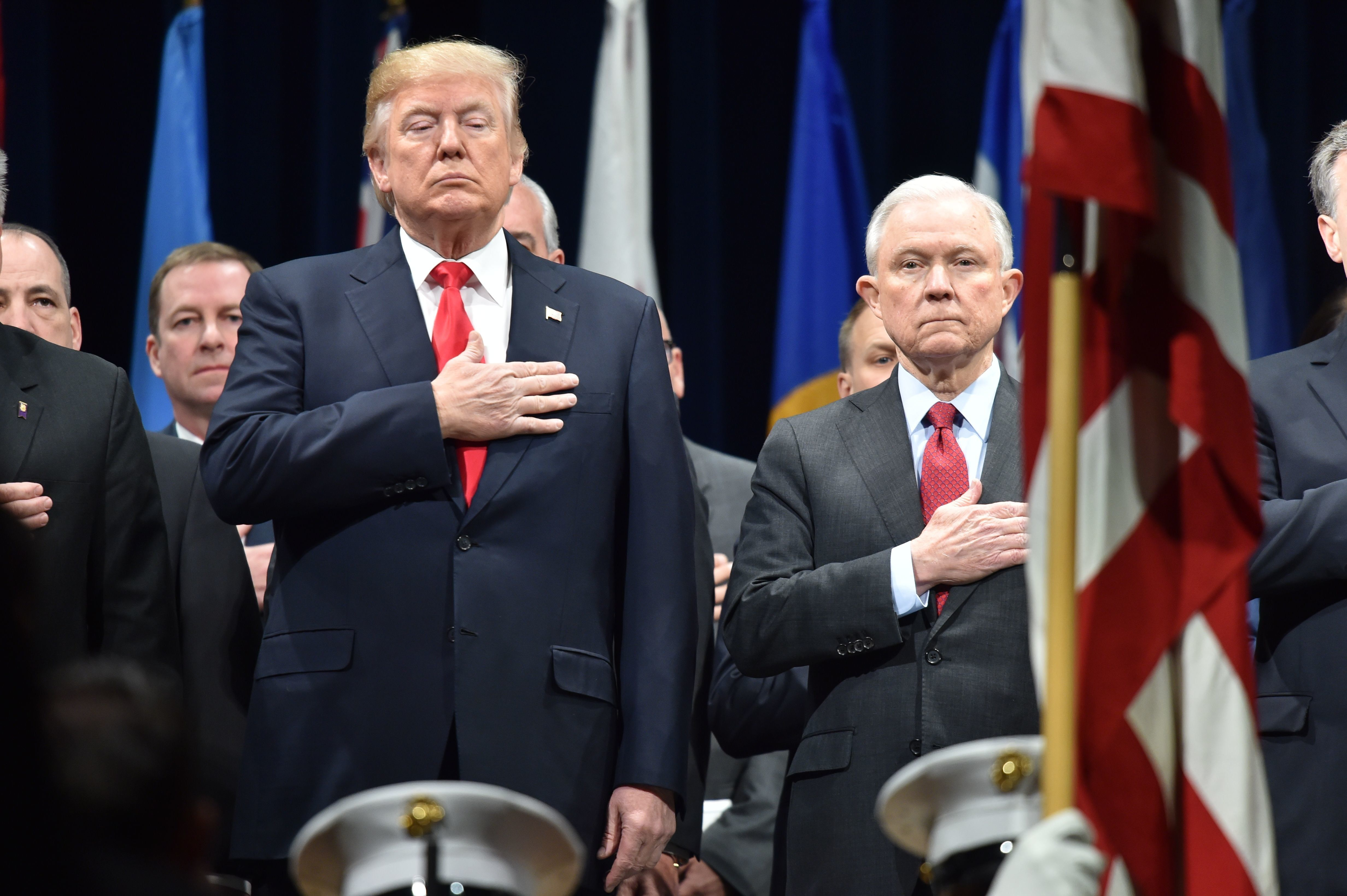 US President Donald Trump(L)stands with Attorney General Jeff Sessions on December 15, 2017 in Quantico, Virginia, before participating in the FBI National Academy graduation ceremony. / AFP PHOTO / Nicholas Kamm        (Photo credit should read NICHOLAS KAMM/AFP/Getty Images)
