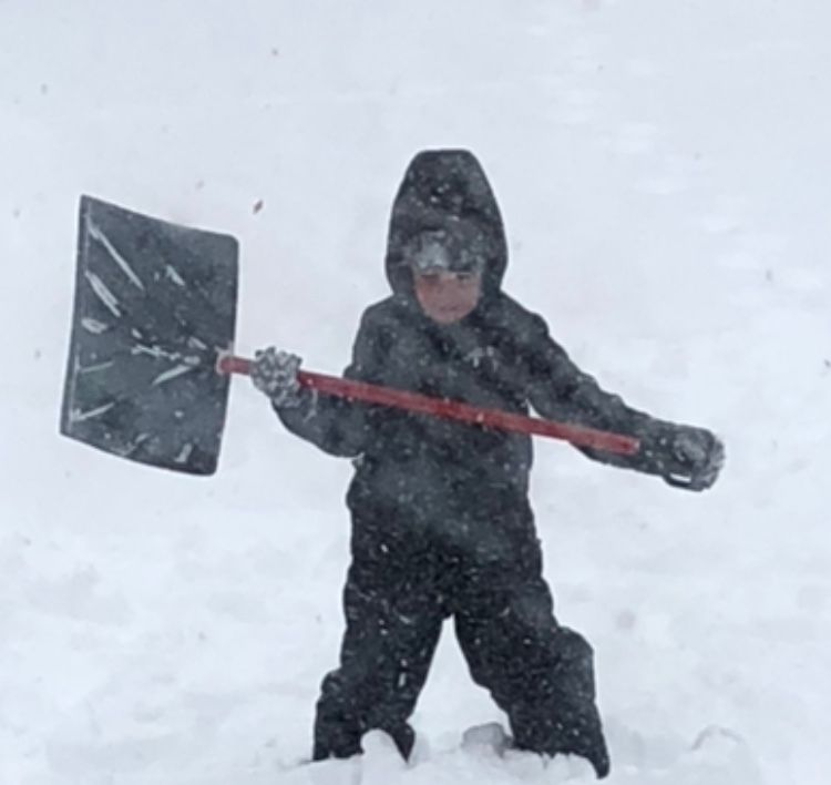 My kid and his shovel. Even he knew he didn't stand a chance in this bomb cyclone shit!
