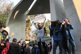 Taking a chance, with a sign held over head, to say once more, we are here and we count #IranianWomen