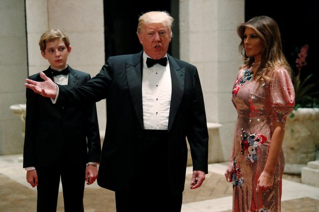 Barron Trump, his father and Melania pictured on New Year's