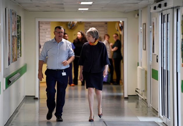 Theresa May has apologised for delays to thousands of NHS operations as a result of winter